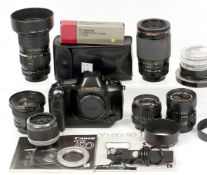 Extensive Canon T90 Camera Outfit. To include camera, Canon FD 17mm f4, 35-105mm f3.5, 50mm f1.