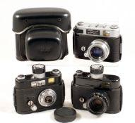 Three Robot Star Cameras & Lenses. Comprising Robot Star 50 with Primotar 30cm f3.