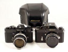 Black Nikon F & Nikkormat Cameras. Nikon F Photomic #6974465 with 28mm f3.