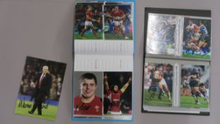 Sports signed photos in two folders signatures include Gareth Edwards, Graham Price, Robert