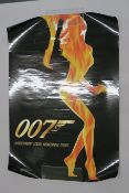 Collection of three rolled condition James Bond film posters including The World is Not Enough Flame