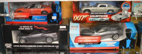 4 James Bond diecast model cars; which includes; Aston Martin V12 Vanquish 1:16 scale etc (4)  [