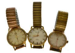Three gents gold plated wristwatches to include an Automatic Doxa together with a Watches Of