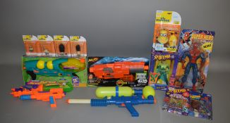 A mixed lot which includes; A Original Super Soaker gun by Larami, Spiderman, Nerf Gun, minions
