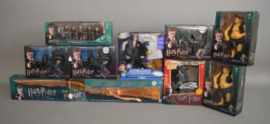 9 boxed Harry Potter items, including; figures, Firebolt broomstick etc (9).