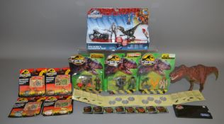 Jurassic Park mixed lot which includes; diecast figures, coins, figure sets etc