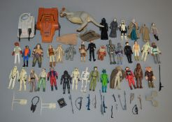 35 loose Star Wars vintage figures which includes weapons, a Taun Taun and some vehicles