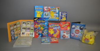 A mixed lot of Pokemon items, which includes; Game boy Color, Trading cards etc