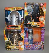 3 boxed Doctor Who radio controlled Daleks plus a Cyberman voice changer, also boxed (4).