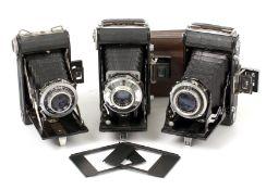 Three Kinax Folding Roll Film Cameras. Including a Super Kinax model (condition 4/5F) and a Kinax
