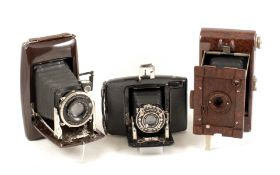 Group of Three Folding Bakelite Roll Film Cameras. Comprising two uncommon Ebner cameras (both