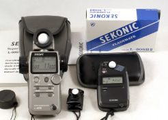 Two Sekonic Digital Flash & Ambient Exposure Meters. Comprising a Sekonic Super Zoom Master L-608