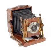 Houghton & Son Quarter Plate Sanderson Field Camera. (bellows rough, otherwise condition 5F).