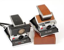 A Pair of Polaroid SX-70 Instant Print Cameras. Comprising a chrome and tan SX-70 with soft case and