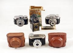 Group of Four Sub-Miniature Cameras. Black Coronet Midget, with instructions and remains of original