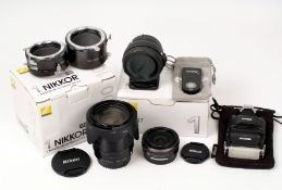 Nikon V1 Digital Accessories. To include 10mm wide angle lens (condition 4E); VR 10-100mm f4-5.6