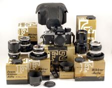 Extensive Nikon F2 Photomic Outfit. Comprising F2 body #7234129 (condition 5F) in maker's box,