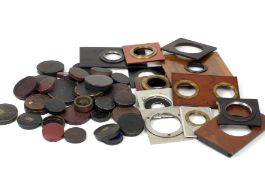 A Small Quantity of Lens Caps, Mostly Early/Vintage. Also a small number of lens panels, including a