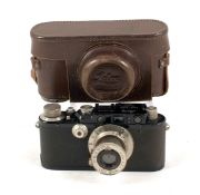 Black Leica III #119658. Small 'infill' to top plate where flash synch has been removed(?). Wear