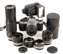 A Good Canon AE1 Program Outfit. Comprising AE1 Program body (condition 5F) with FL 35mm f3.5