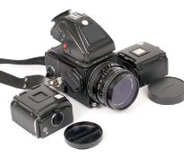 Hasselblad 501CM Medium Format Outfit. Comprising camera body, (condition 5/6F); PME45 prism (unable