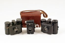 Group of Three Sub-Miniature Cameras. Early (metal) Sida with case, later (plastic) Sida and a UK