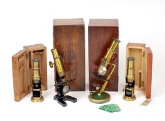 A Good Group of Four Brass Bound Microscopes. To include a late C19 example with unusual ball &