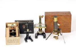 Group of Brass & Other Microscopes. Including one with unusual, folding legs. Three in fitted boxes.