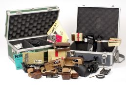 A Quantity of Rolleiflex Accessories, inc Hoods, Filters, Grips etc. (condition 4/5) contained in