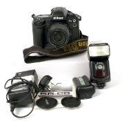 Nikon D1X DSLR Outfit #1. Comprising well used camera body #5125546 (condition 6E) with Nikkor ED