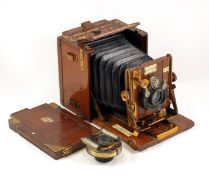 A Tropical Sanderson Hand & Stand Quarter Plate Camera. (condition 5/6F). Fitted with Ross 5 1/2