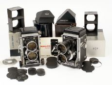 Two Mamiya C33 120 TLR Cameras. One with 135mm f4.5 lenses, the other with 180mm f4.5 lenses. (all