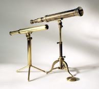 Two Modern Reproduction Telescopes on Collapsible Stands. One by Tasco. (Cabinet Y)