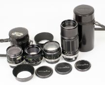 Four Early Minolta Rokkor MD Fit Lenses. Comprising HG 35mm f2.8 (filter stuck) with hood and
