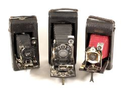 Three Folding Roll Film Cameras, One with Clockwork Motor Wind. To include a Ansco Semi Automatic,