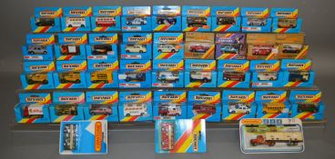 35 boxed Matchbox Superfast models, mostly in blue window box packaging with red and yellow