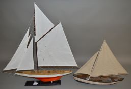 A plastic model of a sailing boat with single mast and two sails, length approximately 55cm,