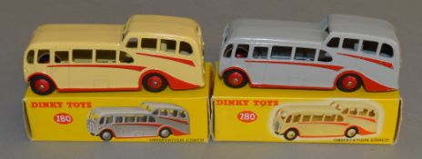 2 boxed Dinky Toys 280 Observation Coach models - Cream with red flashes and hubs, and Grey with
