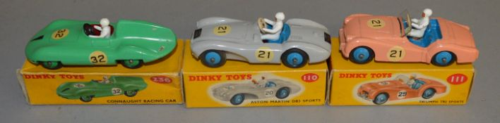 3 boxed Dinky Toys, 110 Aston Martin in grey, 111 Triumph TR2 Sports in pink and 236 Connaught in