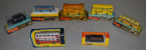 5 boxed Dinky Toys including 284 Taxi, 293 Swiss PTT Coach, 296 Duple Viceroy Coach and 2 x #295 '