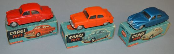 3 boxed Corgi Toys diecast model cars, all of which are mechanical versions, 201M Austin Cambridge