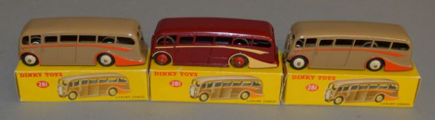 3 boxed Dinky Toys 281 Luxury Coach models - Maroon with cream flashes and red hubs together with