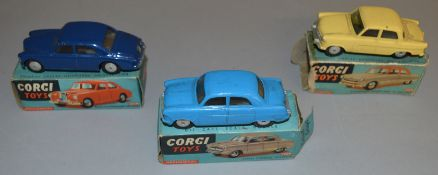 3 boxed Corgi Toys diecast model cars, all mechanical versions, including 205M Riley Pathfinder in