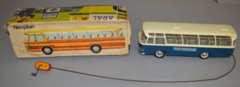 A scarce boxed  Rex (Germany) Neoplan Bus model with .'Telesteering'. This blue and white plastic