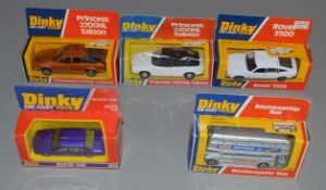 5 boxed Dinky Toys including a scarce version of the #289 Routemaster Bus with silver paintwork