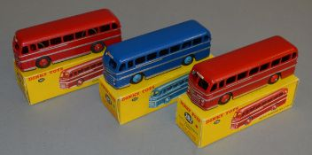 3 boxed Dinky Toys 282 Duple Roadmaster Coach models - two in Red with Silver Coachlines and red