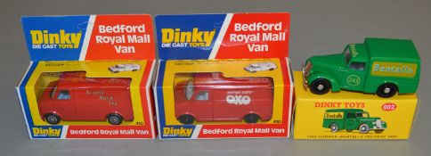2 boxed Dinky Toys 410 red Bedford Vans, produced for John Gay, with 'Brooke Bond Tea' and 'Oxo'