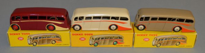 3 boxed Dinky Toys 281 Luxury Coach models - Maroon with cream flashes and red hubs, Fawn with