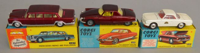 3 Corgi Toys, 239 Volkswagen 1500 Karmann Ghia in white,overall G but has 'Hackney Carriage'