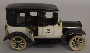 A scarce Bing German tinplate car model with two-tone black and grey finish, driver figure at the
